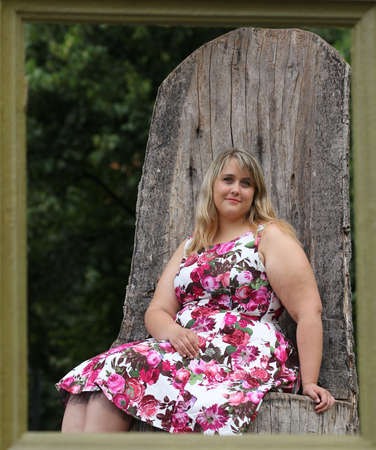 young plus size model and the wooden photo frame