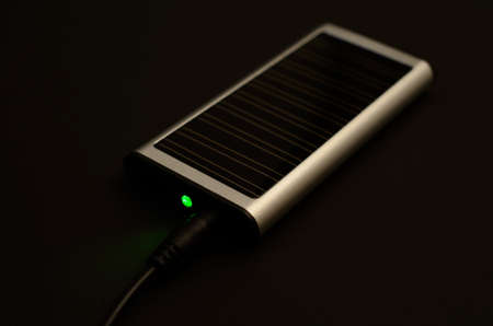 monocrystalline: Solar charger with jack and green LED Stock Photo