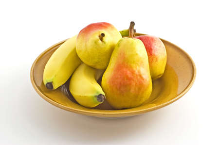 Fresh pears, bananas, apple in yellow bowl, on white background