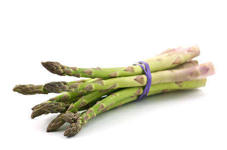Fresh market asparagus isolated on white background