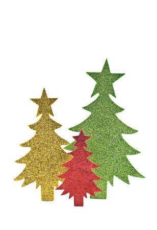 Sparkly green, gold and red paper trees isolated on white background with room for copy, in vertical format Reklamní fotografie