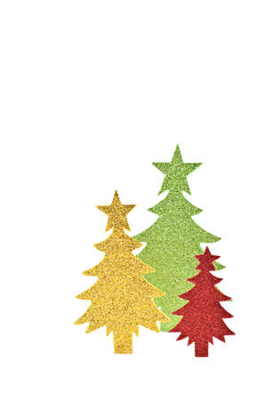 Sparkly green, gold and red paper trees isolated on white background with room for copy, in vertical format Stock Photo