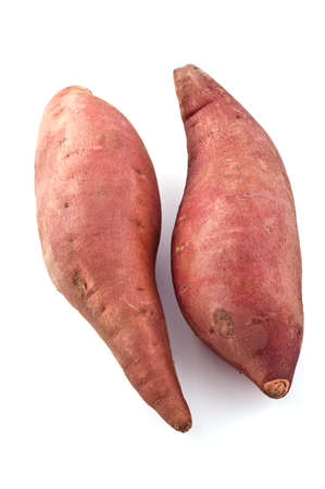 Sweet potatoes isolated on white background, vertical format Stock Photo