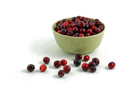 Fresh cranberries in pale green bowl isolated on white background Stock Photo