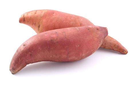 Raw, whole Sweet potatoes isolated on white background