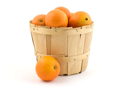 Wooden basket of ripe oranges isolated on white background