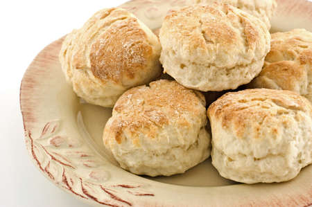 Freshly baked golden scones on rustic plate