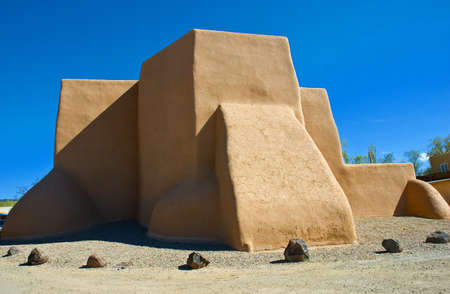 The famous St. Francis de Asis Church in Ranchos de Taos, New Mexico, painted and photographed by many famous artists and photographers such as Georgia OKeeffe and Ansel Adams Stock Photo