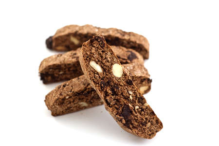 Fresh baked chocolate almond biscotti isolated on white background with selective focus on front biscotti Reklamní fotografie