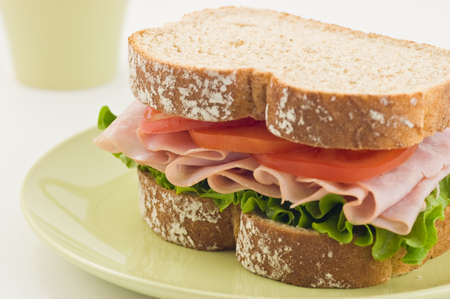 Healthy ham sandwich with lettuce and tomato on whole wheat bread