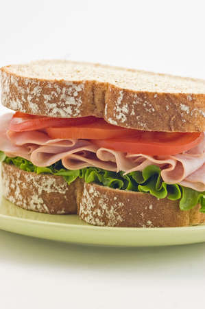 Healthy ham sandwich with lettuce and tomato on whole wheat bread Stock Photo - 11161591