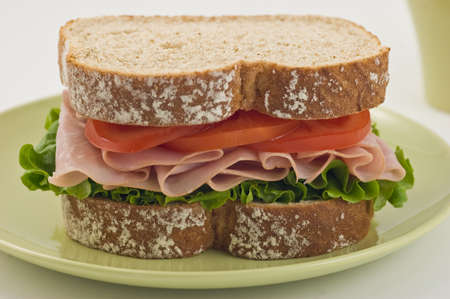 Healthy ham sandwich with lettuce and tomato on whole wheat bread Stock Photo - 11161594