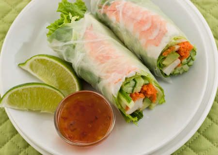 Prawn summer roll sushi with sweet chili sauce and lime on white plate Stock Photo