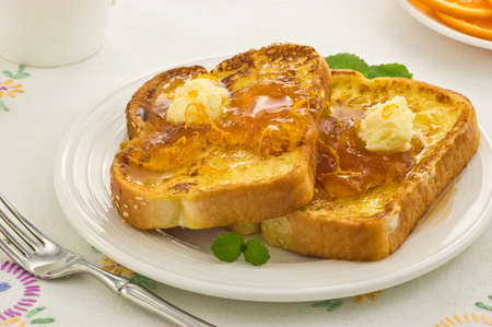 Freshly cooked French Toast with warm Marmalade and whipped butter Stock Photo