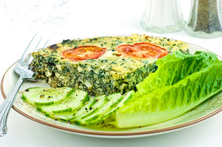 Spinach and feta cheese quiche with lettuce and cucumber  Stock Photo