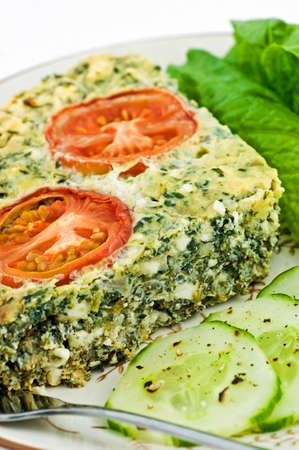 Spinach and feta cheese quiche with lettuce and cucumber in vertical format