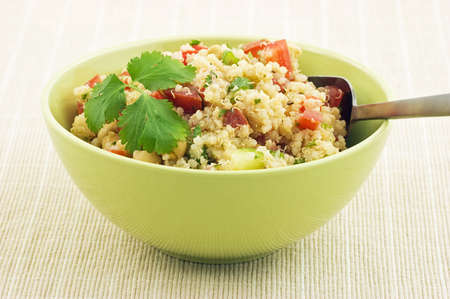 Healthy Quinoa salad in bright green bowl