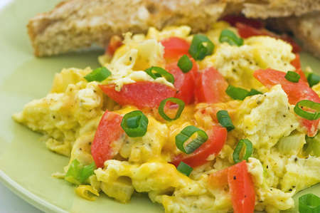 Scrambled eggs with red pepper, green onion and cheddar cheese, with warm buttered whole wheat toast Stock Photo - 11775509