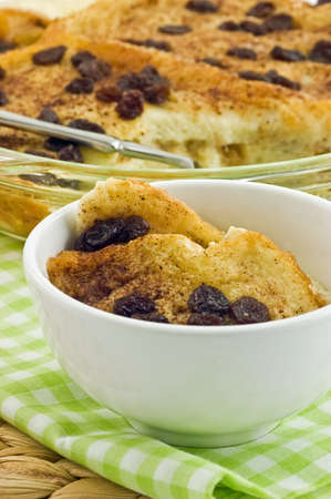 Homemade tasty bread pudding with raisins, in vertical format Stock Photo