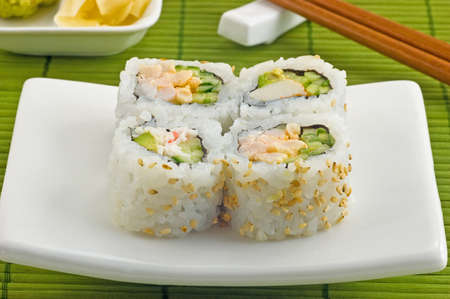 Full Moon combo sushi with ginger and wasabi on green bamboo mat Stock Photo - 11775533