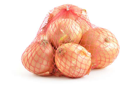 Cooking onions in red mesh bag isolated on white background Stock Photo