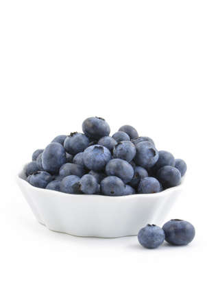 Fresh washed blueberries in small white dish, vertical format Stock Photo