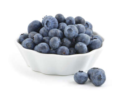 Fresh washed blueberries in small white dish