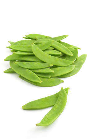 Fresh raw snow peas isolated on white background in vertical format Stock Photo