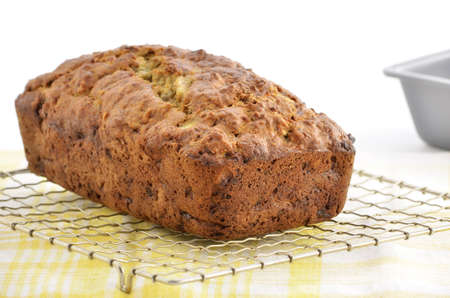 Fresh baked banana bread cooling on metal rack in horizontal format photo