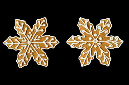 Gingerbread snowflake cookies isolated on black  photo