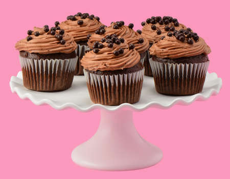 cakestand: Gourmet chocolate cupcakes on pretty ruffled cakestand on a pink