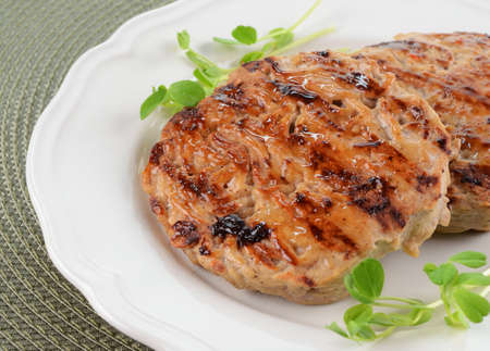 Grilled turkey burgers with sweet chili sauce brushed on