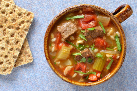 Hearty healthy beef and barley vegetable soup from overhead perspective