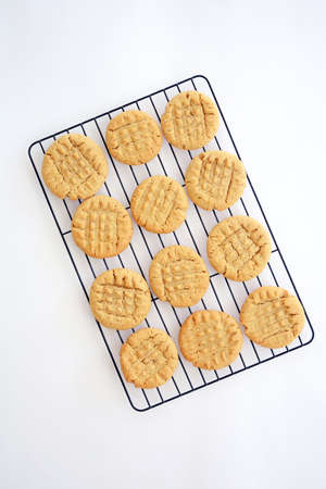 cross hatching: Fresh baked peanut butter cookies cooling on black rack shot from overhead in natural light