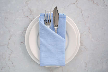 Simple blue and white place setting shot from overhead in natural light