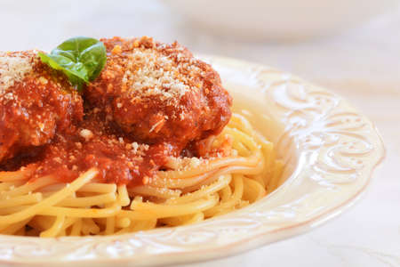 Rich and hearty spaghetti and meatballs in marinara sauce.  Closeup with room for text. Stock Photo