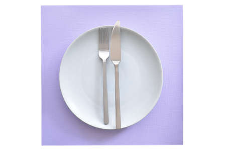 Grey textured plate and stainless steel cutlery with matte finish on mauve linen background in flat lay composition.   Stock fotó