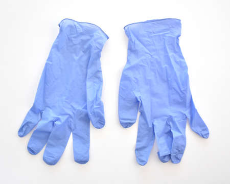 Disposable purple medical latex gloves on white background.  Healthcare equipment concept.