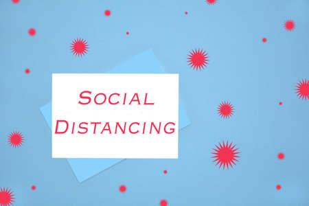 Social distancing notecard on blue background illustrating emergency communication to general public Reklamní fotografie