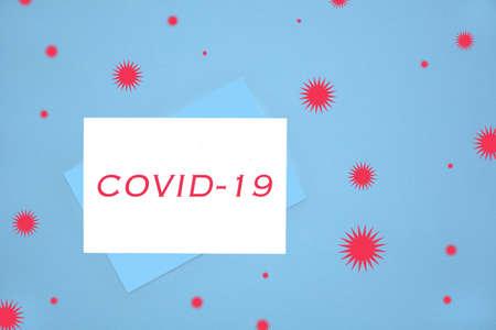COVID-19 notecard on blue background illustrating emergency communication to general public