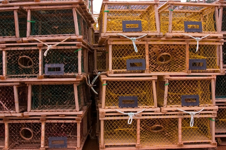 Four rows of rectangular lobster traps, composition with rule of thirds. Stock Photo
