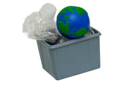 Concept picture with recycled water bottles with an Earth globe in a gray recycling bin. photo