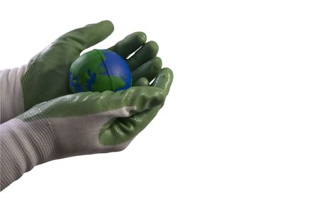 grasp: Environmental protection concept picture; two hands gloved in green holding the Earth globe; work path. Stock Photo