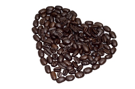 Solid heart shape made of black roasted coffee beans. Concept picture for coffee being good for heart.
