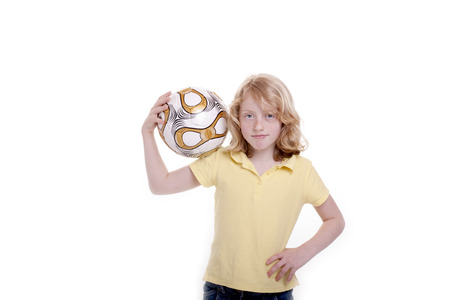 Small girl with a football in the hand
