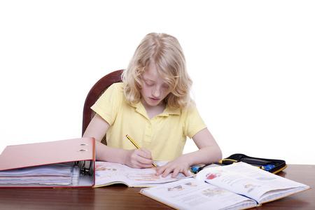 A girl makes homework Banque d'images