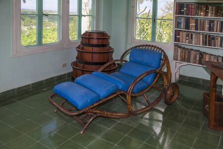 Havana, Cuba - 12 January 2013: The house of Ernest Hemingway, Finca Vigía in San Francisco de Paula. A view into the living room. A blue couch where the writer took breaks from work.