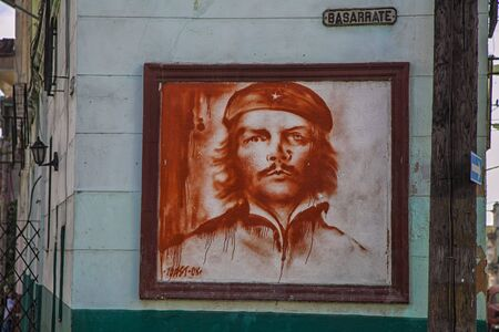 Havana, Cuba - 07 January 2013: Views of town center of squares and streets. A Che Guevara portrait painted on the wall Editorial
