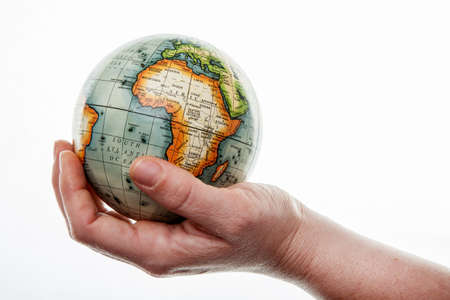 Hands hold the globe on a white background. Stok Fotoğraf