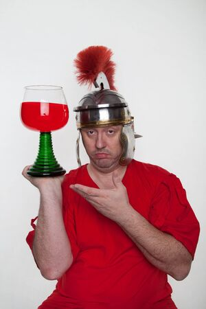 A roman soldier drunk with a glass of wine on the white background.